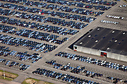 Nederland, Limburg, Gemeente Sittard-Geleen, 07-03-2010; parkeerterrein (depot) Born Car Center gelegen tussen A2 en haven van de Maas. Op het terrein door NedCar geproduceerde personenauto's (Mitsubishi)..Parking lot (deposit) Born Car Center situated between A2 and port of the Meuse. NedCar produces cars for Mitsubishi..luchtfoto (toeslag), aerial photo (additional fee required).foto/photo Siebe Swart
