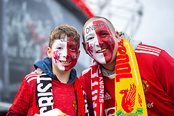 © Licensed to London News Pictures. 24/10/2021. Manchester, UK. Father and son MATTHEW and ETHAN BROOKS wear co-ordinated facepaint in support of Manchester United manager Ole Gunnar Solskjaer . Football fans outside Old Trafford ahead of a Premier League tie between Manchester United and Liverpool . Photo credit: Joel Goodman/LNP