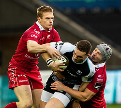 George North of Ospreys is tackled by  Jonathan Davies of Scarlets<br /> <br /> Photographer Simon King/Replay Images<br /> <br /> Guinness PRO14 Round 11 - Ospreys v Scarlets - Saturday 22nd December 2018 - Liberty Stadium - Swansea<br /> <br /> World Copyright © Replay Images . All rights reserved. info@replayimages.co.uk - http://replayimages.co.uk