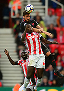Olivier Giroud of Arsenal and Kurt Zouma of Stoke city battle for the ball. Premier league match, Stoke City v Arsenal at the Bet365 Stadium in Stoke on Trent, Staffs on Saturday 19th August 2017.<br /> pic by Bradley Collyer, Andrew Orchard sports photography.
