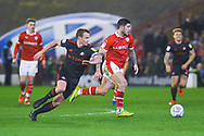 Alex Mowatt of Barnsley (27) gets away from Lee Cattermole of Sunderland (6) during the EFL Sky Bet League 1 match between Barnsley and Sunderland at Oakwell, Barnsley, England on 12 March 2019.