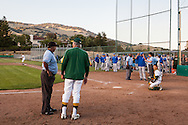 Umpires explain their decision to suspend North Coast Section Division 3 championship game between San Marin High School and Acalanes High on June 6, 2011.  The final score remained 4-4, when NCS officials later declared both teams Co-champions.