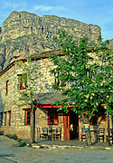 "Stay in a pension under the impressive Tymfi Massif, in Vikos village, Zagoria, north Pindus Mountains (Pindos or Pindhos), Epirus/Epiros, Greece, Europe. The northeast wall of Vikos Gorge is Mount Tymfi (or Greek: , also transliterated Timfi, Tymphe, or Tymphi), near the 40 degree parallel. Tymfi forms a massif with its highest peak, Gamila, at 2497 meters (8192 feet), the sixth highest in Greece. Vikos Gorge in northern Greece is the world's deepest canyon in proportion to its width, and at one point measures 2950 feet (900 meters) deep and 3600 feet (1100 meters) wide from rim to rim. Its depth is an impressive 82% of its width at that cross-section (depth/width ratio=0.82). Gorges in many countries have higher depth/width ratio, but none are as deep. Zagori (Greek: ) is a region and a municipality in the Pindus mountains in Epirus, in northwestern Greece. Zagori contains 45 villages collectively known as Zagoria (Zagorochoria or Zagorohoria). Published in ""Pindos: The National Park"" (2010) by Alexander G. Tziolas, preface by Tom Dempsey et al, ISBN 978-960-98795-3-8."
