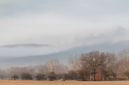 Cornwall, New York - Fog covers parts of Schunnemunk Mountain on a warm winter morning on Feb. 15, 2018.