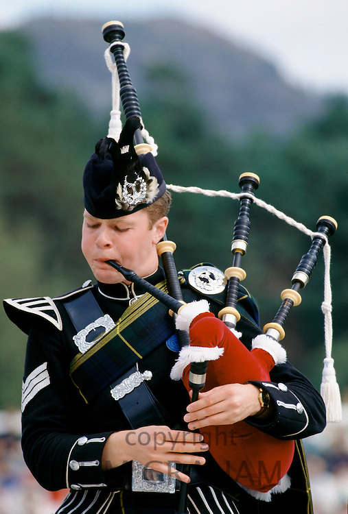 Traditional Scottish piper with bagpipes at the Braemar Royal Highland Gathering, the Braemar Games in Scotland