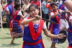 April 14, 2018 - Guwahati, Assam, India - Artists performing folk dance of Assam during Latasil Bihu Sanmilan..Latasil Bihu Sanmilan, one of the oldest Bihu cultural event organisers, organises the Bihu Xomragyi (Bihu Queen) contest every Rongali Bihu. (Credit Image: © David Talukdar/Pacific Press via ZUMA Wire)