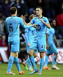 Tottenham Hotspur's Vlad Chiriches celebrates with Tottenham Hotspur's Nabil Bentaleb on the final whistle - Photo mandatory by-line: Joe Meredith/JMP - Tel: Mobile: 07966 386802 19/01/2014 - SPORT - FOOTBALL - Liberty Stadium - Swansea - Swansea City v Tottenham Hotspur - Barclays Premier League