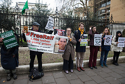 London, UK. 31 January, 2020. Campaigners from English PEN, ALQST and Reporters Without Borders hold a vigil outside the Saudi embassy in solidarity with writers, journalists and activists at risk and imprisoned in Saudi Arabia. The vigil marked five years since the public flogging of imprisoned blogger Raif Badawi on 9 January 2015.