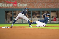 March 26, 2018 - Atlanta, GA, U.S. - ATLANTA, GA - MARCH 26: New York Yankees C Didi Gregorius (18) tags out Atlanta Braves CF Ender Inciarte (11) at second base during the MLB Spring Training baseball game between the New York Yankees and the Atlanta Braves on March 26, 2018 at Suntrust Field in Atlanta, Ga. (Photo by John Adams/Icon Sportswire) (Credit Image: © John Adams/Icon SMI via ZUMA Press)