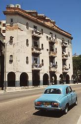 Blue car driving along Havana Street,