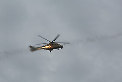 Licensed to London News Pictures. 01/04/2017. Mosul, Iraq. An Iraqi Army Aviation Mi-35 Hind attack helicopter fires rockets at ISIS positions in West Mosul, Iraq, today (01/04/2017). Iraqi forces continue to fight house to house as they push further into West Mosul. Iraqi forces are now advancing on the city's old districts where Islamic State fighters still hold out. Photo credit: Matt Cetti-Roberts/LNP