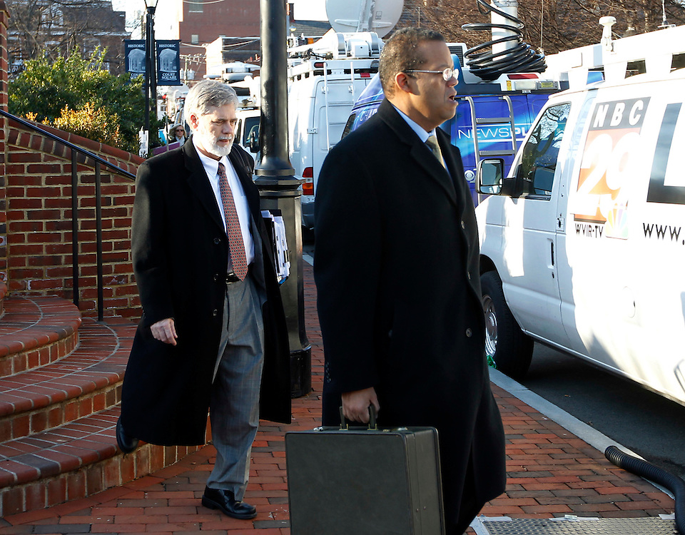 CHARLOTTESVILLE, VA - FEBRUARY 15: Commonwealth attorneys Dave Chapman, left, and attorney Claude V. Worrell, II, right, walk to the Charlottesville Circuit courthouse for the George Huguely trial. Huguely was charged in the May 2010 death of his girlfriend Yeardley Love. She was a member of the Virginia women's lacrosse team. Huguely pleaded not guilty to first-degree murder. (Credit Image: © Andrew Shurtleff