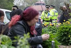 "© Licensed to London News Pictures . 20/04/2014 . Manchester , UK . Police stand at the edge of the park area used by protesters but do not enter the area . Proponents for the legalisation of cannabis gather in Heaton Park in Manchester for "" 420 Day "". The event is organised by pro-cannabis groups ManCan and Mannijuana and is one of many taking place in cities across the world today (Sunday 20th April 2014) . Photo credit : Joel Goodman/LNP"