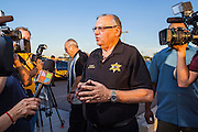 """23 JUNE 2012 - PHOENIX, AZ:  Maricopa County Sheriff JOE ARPAIO talks to reporters during a press conference on front of his jails Saturday afternoon. About 2,000 members of the Unitarian Universalist Church, in Phoenix for their national convention, picketed the entrances to the Maricopa County Jail and """"Tent City"""" Saturday night. They were opposed to the treatment of prisoners in the jail, many of whom are not convicted and are awaiting trial, and Maricopa County Sheriff Joe Arpaio's stand on illegal immigration. The protesters carried candles and sang hymns.      PHOTO BY JACK KURTZ"""