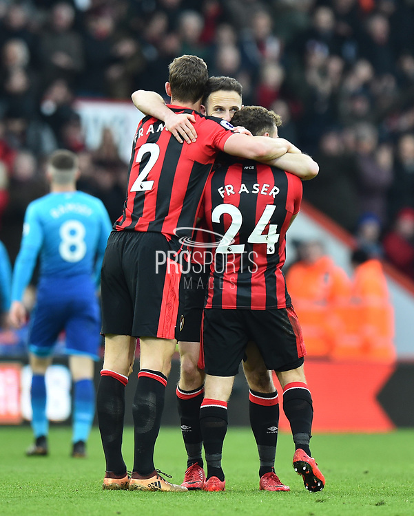 Simon Francis (2) of AFC Bournemouth, Ryan Fraser (24) of AFC Bournemouth and Marc Pugh (7) of AFC Bournemouth celebrate the 2-1 win over Arsenal at full time during the Premier League match between Bournemouth and Arsenal at the Vitality Stadium, Bournemouth, England on 14 January 2018. Photo by Graham Hunt.