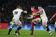 Hadleigh Parkes of Wales is stopped by England's Sam Underhill (20) and Jamie George ®. England v Wales, NatWest 6 nations 2018 championship match at Twickenham Stadium in Middlesex, England on Saturday 10th February 2018.<br /> pic by Andrew Orchard, Andrew Orchard sports photography