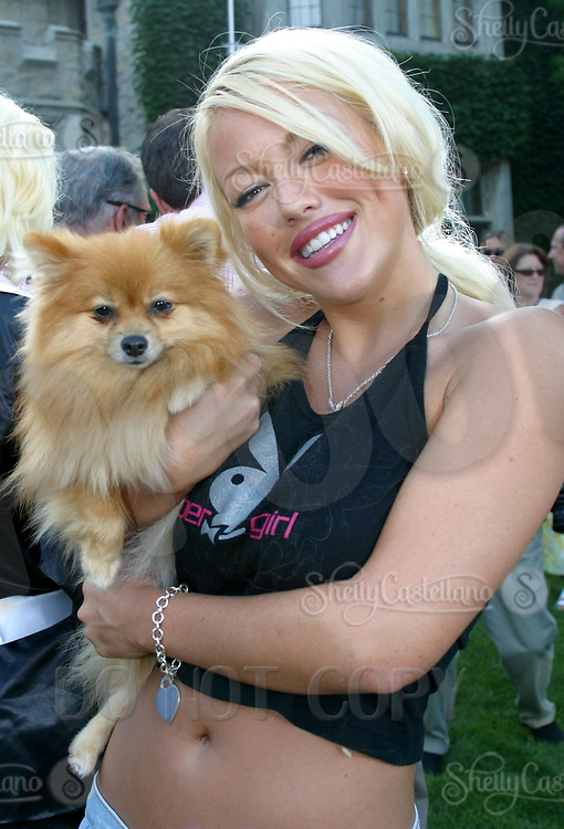 Jul 09, 2002; Los Angeles, CA, USA ;Playmate & Hugh's housemate TIFFANY with her dog DOLCHE @ SUGAR RAY LEONARD BOXING first year anniversary was celebrated with a live fight night on ESPN2 from the Playboy Mansion in Holmby Hills.  Over 350 invited guests attended the cocktail reception and showdown in the back yard of Playboy HUGH HEFNER's 5 1/2 acre estate. <br />Mandatory Credit: Photo by Shelly Castellano/ZUMA Press.<br />(©) Copyright 2002 by Shelly Castellano
