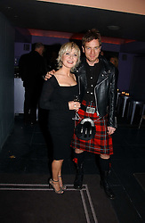 LULU and EWAN McGREGOR at a Burns Night dinner in aid of CLIC Sargent and Children's Hospice Association Scotland held at St.Martin's Lane Hotel, St.Martin's Lane, London on 25th January 2007.<br />