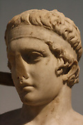 The head from a Roman statue of a victorious young athlete. 1st century AD. Remade from a Greek original of about 430 BC. The athlete shown tying a ribbon around his head showing his victory in competition.
