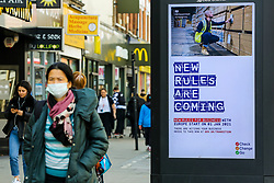 © Licensed to London News Pictures. 19/10/2020. London, UK. A woman in north London walk past the government's publicity campaign 'NEW RULES ARE COMING' for firms that trade with Europe to prepare for a no-deal Brexit. HMRC will contact over 200,000 firms that trade with the EU to set out the new customs and tax rules and how to deal with them. Photo credit: Dinendra Haria/LNP