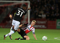 Kyle Storer of Cheltenham Town slides in on Edimilson Fernandes of West Ham United - Mandatory by-line: Paul Roberts/JMP - 23/08/2017 - FOOTBALL - LCI Rail Stadium - Cheltenham, England - Cheltenham Town v West Ham United - Carabao Cup