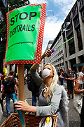 Woman demonstrating against Chemtrails. The chemtrail conspiracy theory holds that some trails left by aircraft are actually chemical or biological agents deliberately sprayed at high altitudes for a purpose undisclosed to the general public in clandestine programs directed by government officials. As a result of the popularity of the theory, official agencies have received thousands of complaints from people who have demanded an explanation. The existence of chemtrails has been repeatedly denied by government agencies and scientists around the world, who say the trails are normal contrails. Demonstration in Central London on a day of General Strike action by public sector workers and unions. Civil servants, teachers, health workers all came out on a day of peaceful march and protest against government cuts which look set to see their pensions change.