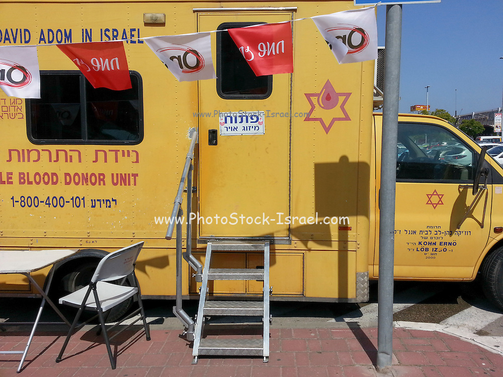 Blood donations are collected in a blood mobile ambulance