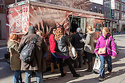 2012 Vendy People's Choice award-winner The Cinnamon Snail pulls up to the curb as people wait to get into the New York Vegetarian Food Festival.