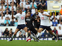 Photo: Chris Ratcliffe.<br /> Tottenham Hotspur v Portsmouth. The Barclays Premiership. 01/10/2006.<br /> Pedro Mendes (C) of Portsmouth clashes with Hossam Ghaly (R) and Jermaine Jenas of Spurs.