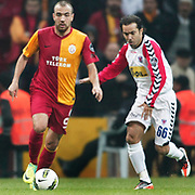 Galatasaray's Sercan YILDIRIM (L) and Mersin Idman Yurdu's Ilhan OZBAY (R) during their Turkish Superleague soccer match Galatasaray between Mersin Idman Yurdu at the Turk Telekom Arena at Aslantepe in Istanbul Turkey on Saturday 05 November 2011. Photo by TURKPIX