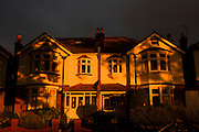Identical Edwardian semi-detached homes in late light in south London.