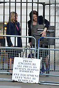 © Licensed to London News Pictures. 05/03/2013. Westminster, UK Int. Development Secretary.Justine Greening (L) and Culture Secretary MariaMiller have difficulty with a gate. Ministers arrive for a Cabinet Meeting at number 10 Downing Street on 5th March 2013. Photo credit : Stephen Simpson/LNP