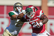 FAYETTEVILLE, AR - OCTOBER 25:  Alex Collins #3 of the Arkansas Razorbacks is tackled by the helmet by Harris Gaston #25 of the UAB Blazers at Razorback Stadium on October 25, 2014 in Fayetteville, Arkansas.  The Razorbacks defeated the Blazers 45-17.  (Photo by Wesley Hitt/Getty Images) *** Local Caption *** Alex Collins; Harris Gaston