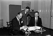 10/05/1965<br /> 05/10/1965<br /> 10 May 1965<br /> (Left to right) Mr. A. Kennedy Kirsch, chairman and managing director of M.E.P.C. (Ireland) Ltd., Mr. John Costello, architect, and Mr. G. C. Crampton, managing director of G. & T. Crampton Ltd., sign the contract for the building of the Stillorgan Shopping Centre.