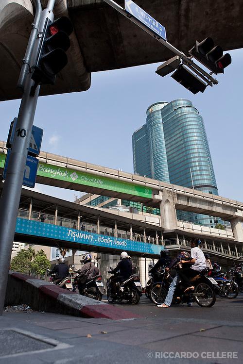 Motorcycles go under an overpass in Bangkok