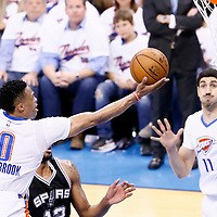 06 May 2016: Oklahoma City Thunder guard Russell Westbrook (0) goes for the layup past San Antonio Spurs forward LaMarcus Aldridge (12) during the San Antonio Spurs 100-96 victory over the Oklahoma City Thunder, during Game Three of the Western Conference Semifinals of the NBA Playoffs at the Chesapeake Energy Arena, Oklahoma City, Oklahoma, USA.