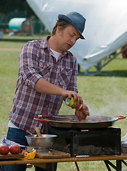 © licensed to London News Pictures. LONDON. UK.  03/07/11. Celebrity chef Jamie Oliver filming for a new cooking programme about festival food at Day three of Jamie Olivers The Big Feastival on Clapham Common today (03/07/2011). The three day event featuring food from some of the country's top chefs and live music,  takes place on Clapham Common on the 1st, 2nd and 3rd July.  Photo Credit Ben Cawthra/LNP