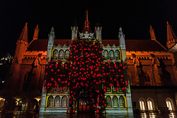"© Licensed to London News Pictures. 05/03/2016. London, UK. Visitors gather to watch the ""Son et Lumière"" at Guildhall.  The spectacular light and sound production celebrates the City's connection to Shakespeare, on the 400th anniversary of his death.  The historic façade of Guildhall is brought to life with 3D projection mapping technology accompanied by a special music composition by the Guildhall School of Music & Drama. Photo credit : Stephen Chung/LNP"