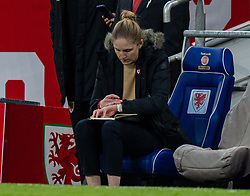 CARDIFF, WALES - Tuesday, April 13, 2021: Wales' head coach Gemma Grainger makes notes during a Women's International Friendly match between Wales and Denmark at the Cardiff City Stadium. (Pic by David Rawcliffe/Propaganda)