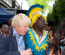 © Licensed to London News Pictures. 29/08/2011. London, UK. London Mayor Boris Johnson visits the Notting Hill Carnival on Bank Holiday Monday and is greeted enthusiastically by Londoners and Carnivalists alike. Photo credit: Bettina Strenske/LNP