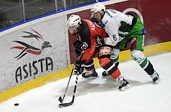 Tomaz Razingar vs Bostjan Groznik at 52nd round of EBEL league ice hockey match between HK Acroni Jesenice and HDD Tilia Olimpija, on January 29, 2009, in Podmezaklja, Jesenice, Slovenia. Acroni Jesenice won 5:3. (Photo by Vid Ponikvar / Sportida)
