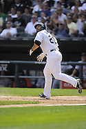 CHICAGO - JULY 27:  Carlos Quentin #20 of the Chicago White Sox bats against the Detroit Tigers on July 27, 2011 at U.S. Cellular Field in Chicago, Illinois.  The White Sox defeated the Tigers 2-1.  (Photo by Ron Vesely)  Subject: Carlos Quentin