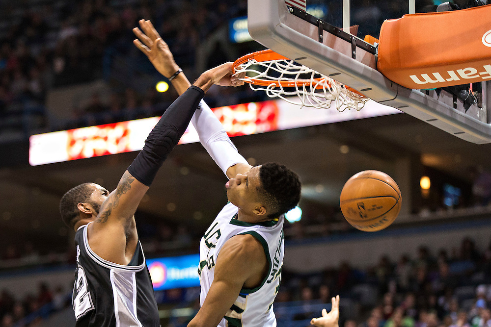 """MILWAUKEE, WI- JANUARY 4:  LaMarcus Aldridge #12 of the San Antonio Spurs dunks the basket ball over Glannis Antetokounmpo #34 of the Milwaukee Bucks at BMO Harris Bradley Center on January 4, 2016 in Milwaukee, Wisconsin.  """"NOTE TO USER: User expressly acknowledges and agrees that, by downloading and or using this photograph, User is consenting to the terms and conditions of the Getty Images License Agreement.""""(Photo by Wesley Hitt/Getty Images) *** Local Caption *** Glannis Antetokounmpo; LaMarcus Aldridge"""