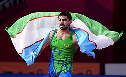 JAKARTA, Aug. 19, 2018  Bekzod Abdurakhmonov of Uzbekistan celebrates after Men's Wrestling Freestyle 74 kg Final against Daniyar Kaisanov of Kazakhstan at the 18th Asian Games at Jakarta, Indonesia, Aug. 19, 2018. (Credit Image: © Yue Yuewei/Xinhua via ZUMA Wire)