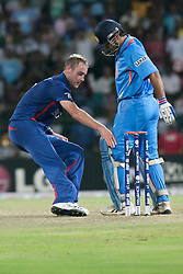 © Licensed to London News Pictures. 23/09/2012. England captain Stuart Broad tries to take the ball out of Indian Captain M.S Dhoni's pad during the T20 Cricket World T20 match between England Vs India at the R.Premadasa Cricket Stadium,Colombo. Photo credit : Asanka Brendon Ratnayake/LNP