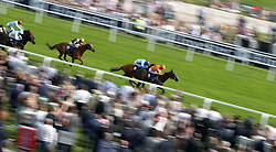 Shared Equity ridden by jockey Jack Garritty on his way to winning the Investec Zebra Handicap during ladies day of the 2018 Investec Derby Festival at Epsom Downs Racecourse, Epsom.