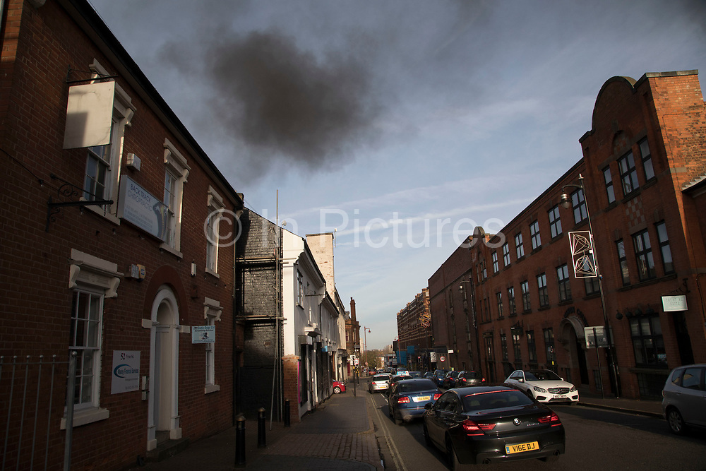 Smoke billowing into the sky from a fire in the Jewellery Quarter in Birmingham, United Kingdom. On investigation this fire turned out to be a man burning polystyrene behind a business, presumably to save on the hassle of recycling such a large volume.