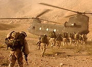 Soldiers board a Chinook helicopter in the invasion of Afghanistan 2001 US 10th Mountain Division soldiers in Afghanistan