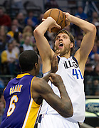 Dirk Nowitzki (41) of the Dallas Mavericks shoots the ball over Earl Clark (6) of the Los Angeles Lakers at the American Airlines Center in Dallas on Sunday, February 24, 2013. (Cooper Neill/The Dallas Morning News)
