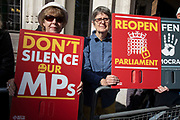 Protesters outside The Supreme Court as the first day of the hearing to rule on the legality of suspending or proroguing Parliament begins on September 17th 2019 in London, United Kingdom. The ruling will be made by 11 judges in the coming days to determine if the action of Prime Minister Boris Johnson to suspend parliament and his advice to do so given to the Queen was unlawful. (photo by Mike Kemp/In Pictures via Getty Images)